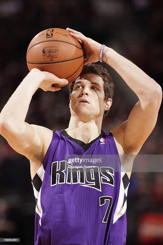 Jimmer Fredette #7 of the Sacramento Kings attempts a foul shot against the Portland Trail Blazers on December 26, 2012 at the Rose Garden Arena in Portland, Oregon.
