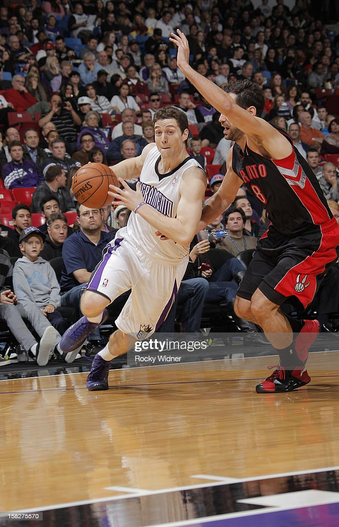 Jimmer Fredette #7 of the Sacramento Kings drives towards hoop against Jose Calderon #8 of the Toronto Raptors on December 5, 2012 at Sleep Train Arena in Sacramento, California.