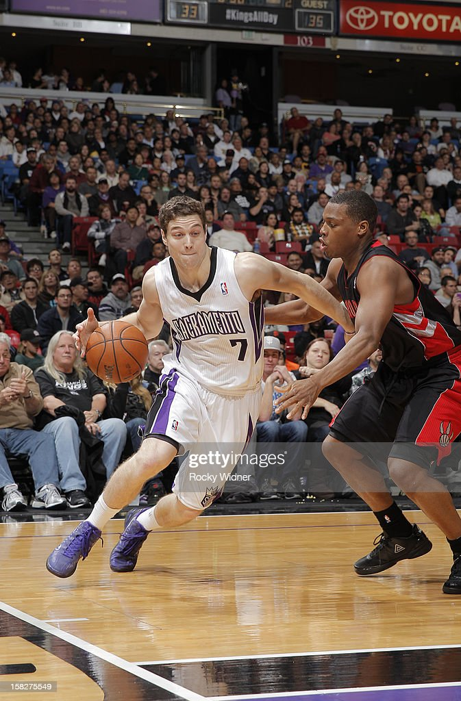 Jimmer Fredette #7 of the Sacramento Kings drives towards the hoop against Kyle Lowry #3 of the Toronto Raptors on December 5, 2012 at Sleep Train Arena in Sacramento, California.