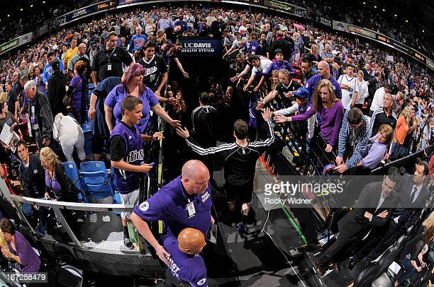 Jimmer Fredette of the Sacramento Kings greets fans while heading into the tunnel after the game against the Los Angeles Clippers on April 17 2013 at...