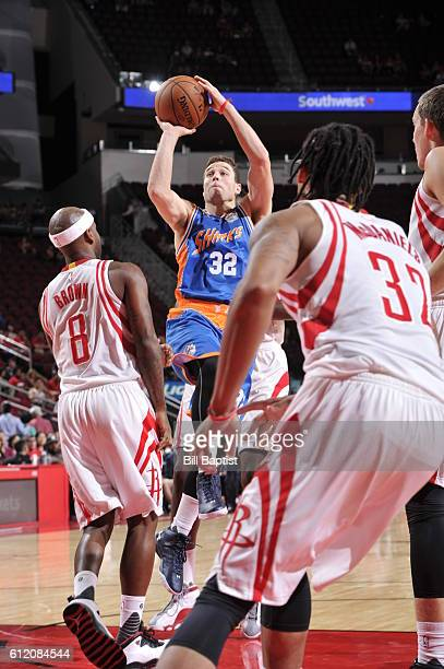 Jimmer Fredette of the Shanghai Sharks goes to the basket against Bobby Brown of the Houston Rockets during a preseason game on October 2 2016 at the...