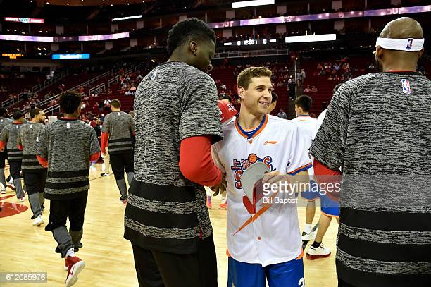 Jimmer Fredette of the Shanghai Sharks is greeted by the Houston Rockets during a preseason game on October 2 2016 at the Toyota Center in Houston...