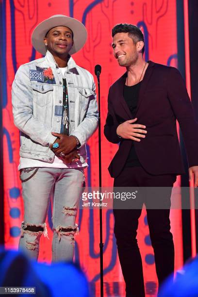Jimmie Allen and Michael Ray perform at the 2019 CMT Music Awards at Bridgestone Arena on June 05 2019 in Nashville Tennessee