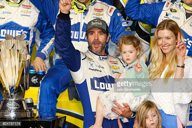 Jimmie Johnson and family celebrate in Victory Circle after winning the 18th annual Ford EcoBoost 400 NASCAR Sprint Cup Series race and the Series...