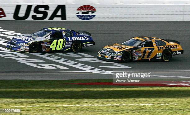 Jimmie Johnson and his car win's in final lap of the UAW-DaimlerChrysler 400.Johnson crosses the finish line fractions of a second ahead of Matt...