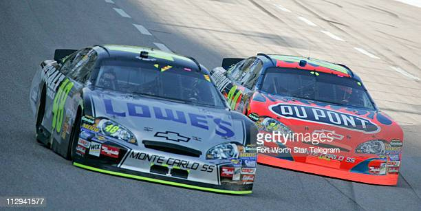 Jimmie Johnson and Jeff Gordon battle for position in turn one early in the NASCAR Nextel Cup series Dickies 500 race at Texas Motor Speedway in Fort...
