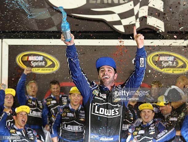 Jimmie Johnson celebrates after winning the Coke Zero 400 at Daytona International Speedway on Saturday July 6 in Daytona Beach Florida