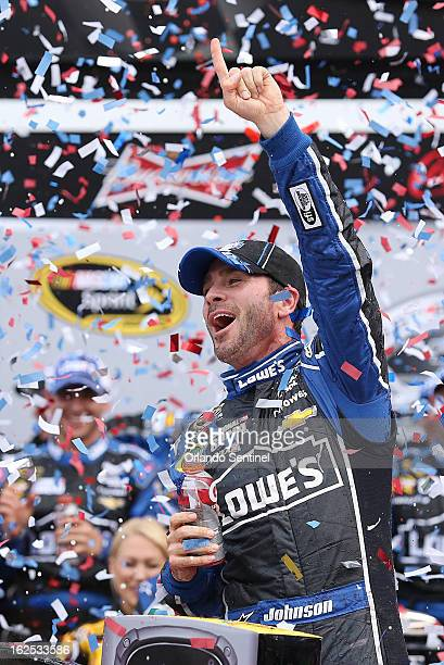 Jimmie Johnson celebrates in Victory Lane after winning the Daytona 500 race at Daytona International Speedway in Daytona Beach Florida Sunday...
