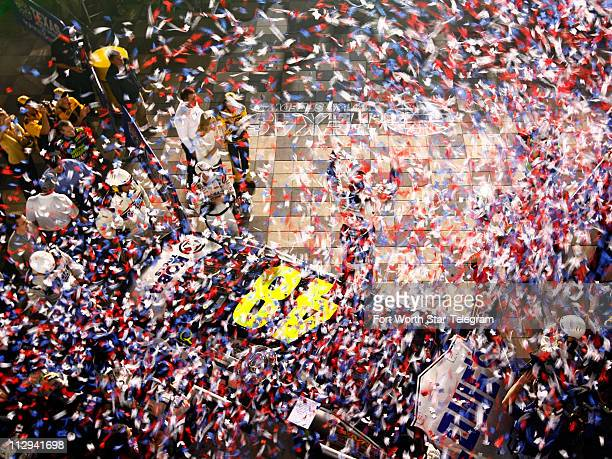 Jimmie Johnson celebrates winning the NASCAR Nextel Cup series Dickies 500 race at Texas Motor Speedway in Fort Worth Texas Sunday November 4 2007