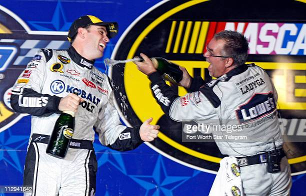 Jimmie Johnson celebrates with his crew member Tim Ladyga after Johnson won the NASCAR Nextel Cup series Dickies 500 race at Texas Motor Speedway in...