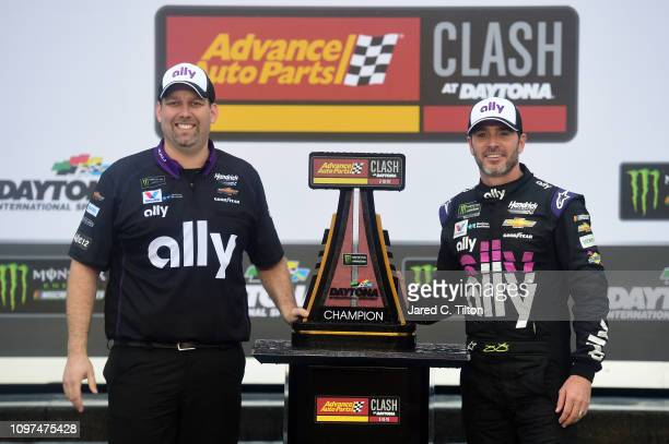 Jimmie Johnson driver of the Ally Chevrolet and crew chief Kevin Meendering celebrate in victory lane after winning the Monster Energy NASCAR Cup...