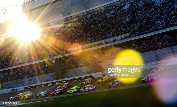 Jimmie Johnson driver of the Ally Chevrolet and Joey Logano driver of the Shell Pennzoil Ford lead the field during the Monster Energy NASCAR Cup...