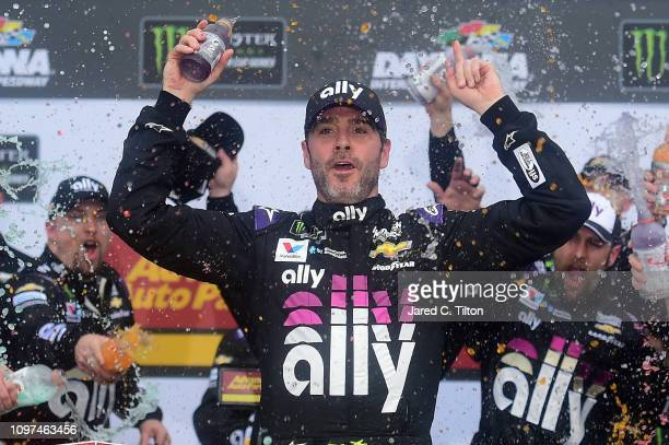 Jimmie Johnson driver of the Ally Chevrolet celebrates in victory lane after winning the Monster Energy NASCAR Cup Series Advance Auto Parts Clash at...