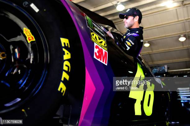 Jimmie Johnson driver of the Ally Chevrolet climbs into his car during practice for the Monster Energy NASCAR Cup Series Auto Club 400 at Auto Club...