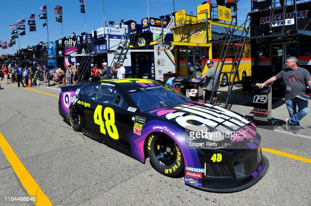 Jimmie Johnson driver of the Ally Chevrolet drives through the garage during practice for the Monster Energy NASCAR Cup Series FireKeepers Casino 400...