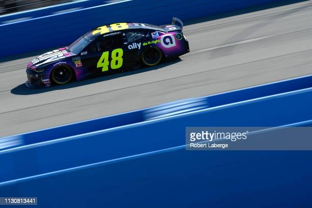 Jimmie Johnson driver of the Ally Chevrolet during qualifying for the Monster Energy NASCAR Cup Series Auto Club 400 at Auto Club Speedway on March...