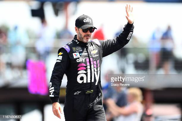 Jimmie Johnson driver of the Ally Chevrolet greets the crowd at driver introductions during the Monster Energy NASCAR Cup Series Consumers Energy 400...