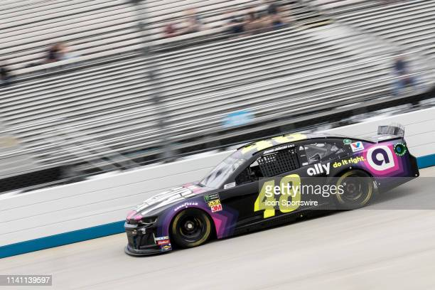 Jimmie Johnson driver of the Ally Chevrolet races down the front stretch during Saturday's only practice for Sunday's Gander RV 400 on May 04 at...
