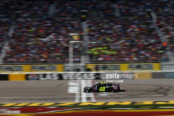 Jimmie Johnson driver of the Ally Chevrolet races during the Monster Energy NASCAR Cup Series Pennzoil Oil 400 at Las Vegas Motor Speedway on March 3...
