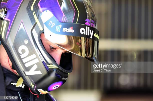 Jimmie Johnson driver of the Ally Chevrolet stands in the garage area during practice for the Monster Energy NASCAR Cup Series Auto Club 400 at Auto...