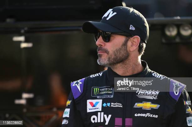 Jimmie Johnson driver of the Ally Chevrolet stands in the garage area during practice for the Monster Energy NASCAR Cup Series Food City 500 at...
