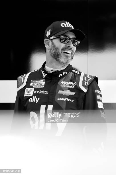 Jimmie Johnson driver of the Ally Chevrolet stands in the garage area during practice for the NASCAR Cup Series 62nd Annual Daytona 500 at Daytona...