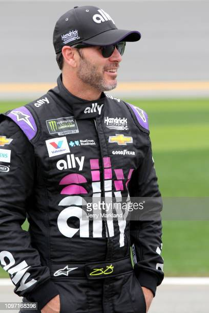 Jimmie Johnson driver of the Ally Chevrolet stands on the grid during qualifying for the Monster Energy NASCAR Cup Series 61st Annual Daytona 500 at...