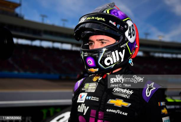 Jimmie Johnson driver of the Ally Chevrolet stands on the grid during qualifying for the Monster Energy NASCAR Cup Series Bluegreen Vacations 500 at...