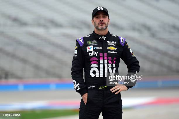 Jimmie Johnson driver of the Ally Chevrolet walks on the grid during qualifying for the Monster Energy NASCAR Cup Series O'Reilly Auto Parts 500 at...
