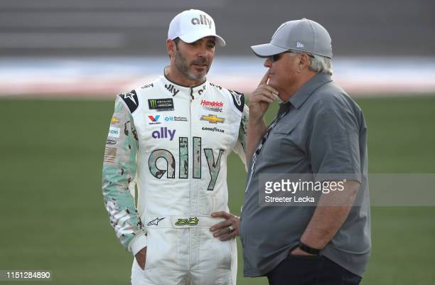 Jimmie Johnson driver of the Ally Patriotic Chevrolet and NASCAR Hall of Famer and team owner Rick Hendrick talk during qualifying for the Monster...