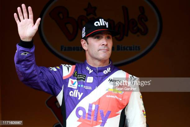 Jimmie Johnson driver of the Ally Throwback Chevrolet walks on stage during driver intros for the Monster Energy NASCAR Cup Series Bojangles'...
