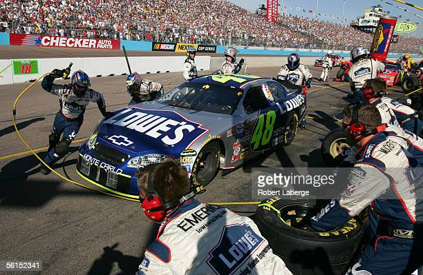 Jimmie Johnson driver of the Hendrick Motorsports Lowe's Chevrolet makes a pit stop during the NASCAR Nextel Cup Series Checker Auto Parts 500 at the...