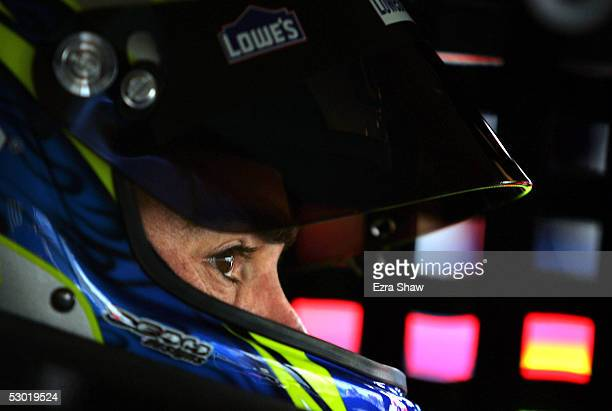 Jimmie Johnson driver of the Hendrick Motorsports Lowe's Chevrolet car sits in his car before practice for the MBNA RacePoints 400 on June 4 at the...