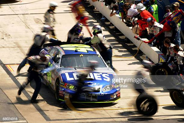 Jimmie Johnson driver of the Hendrick Motorsports Lowe's Chevrolet car gets his car worked on during a pit stop in the NASCAR Nextel Cup MBNA...