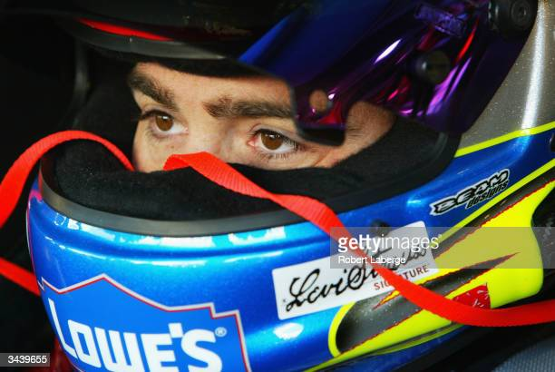 Jimmie Johnson driver of the Hendrick Motorsports Lowe's Chevrolet sits in his car before the start of practice for the NASCAR Nextel Cup Series...
