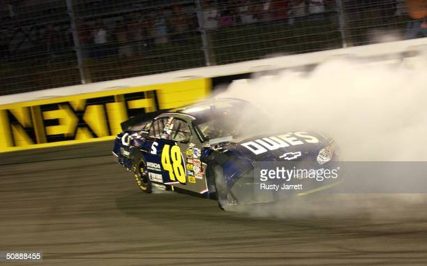 Jimmie Johnson driver of the Hendrix Motorsports Chevrolet spins in turn four during the Nextel AllStar Challenge on May 22 2004 at Lowes Motor...