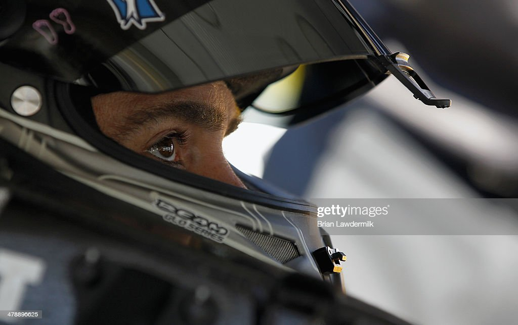 Jimmie Johnson, driver of the #48 Kobalt Tools Chevrolet, sits in his car during practice for the NASCAR Sprint Cup Series Food City 500 at Bristol Motor Speedway on March 15, 2014 in Bristol, Tennessee.