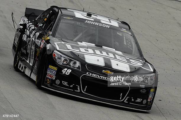Jimmie Johnson driver of the Kobalt Tools Chevrolet trails a strip of his right front tire during the NASCAR Sprint Cup Series Food City 500 at...