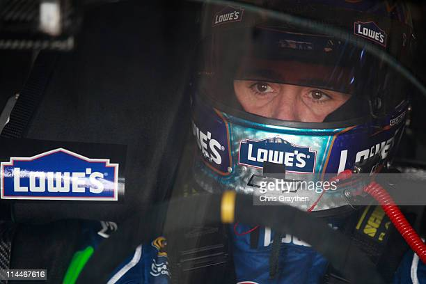 Jimmie Johnson driver of the Lowe's 5% Every Day Chevrolet sits in his car during practice for the NASCAR Sprint AllStar Race at Charlotte Motor...