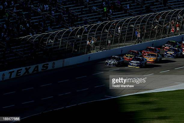 Jimmie Johnson driver of the Lowe's Chevrolet and Brad Keselowski driver of the Miller Lite Dodge lead the field on a restart during the NASCAR...
