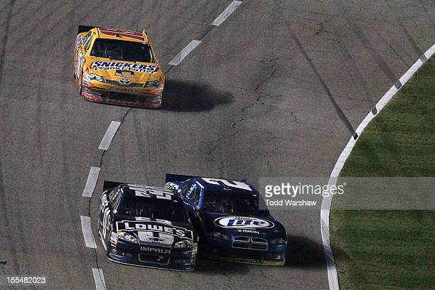Jimmie Johnson driver of the Lowe's Chevrolet and Brad Keselowski driver of the Miller Lite Dodge bump eachother during the NASCAR Sprint Cup Series...