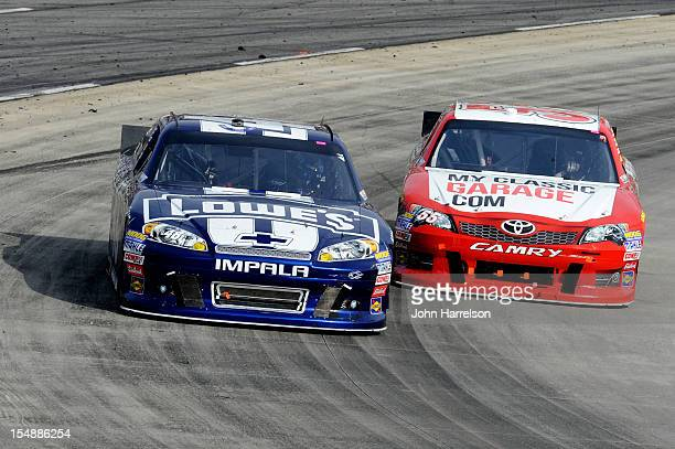 Jimmie Johnson driver of the Lowe's Chevrolet and Brian Vickers driver of the MyClassicGaragecom Toyota race during the NASCAR Sprint Cup Series Tums...