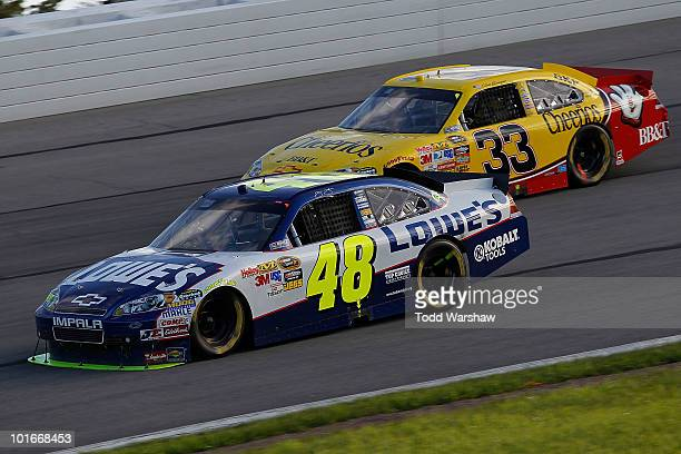 Jimmie Johnson driver of the Lowe's Chevrolet and Clint Bowyer driver of the Cheerios/Hamburger Helper Chevrolet drive during the NASCAR Sprint Cup...