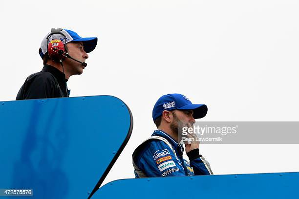 Jimmie Johnson driver of the Lowe's Chevrolet and crew chief Chad Knaus stand on top of their hauler during practice for the NASCAR Sprint Cup Series...