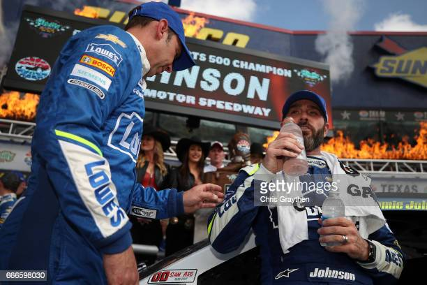 Jimmie Johnson driver of the Lowe's Chevrolet and crew chief Chad Knaus talk after winning during the Monster Energy NASCAR Cup Series O'Reilly Auto...