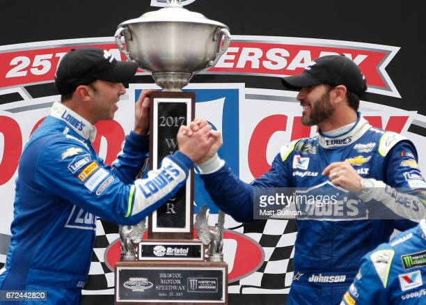 Jimmie Johnson driver of the Lowe's Chevrolet and crew chief Chad Knaus celebrate after winning the Monster Energy NASCAR Cup Series Food City 500 at...