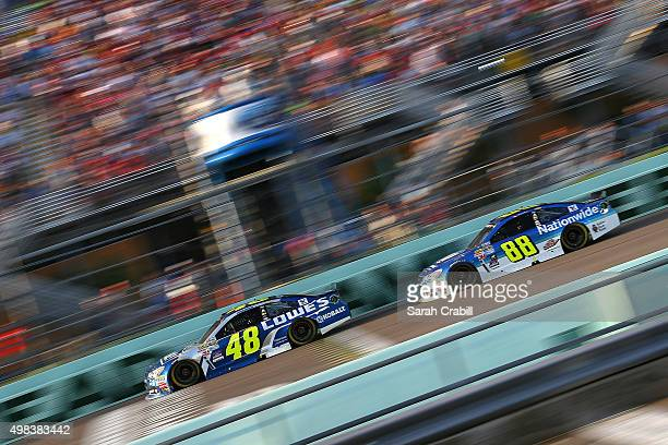 Jimmie Johnson driver of the Lowe's Chevrolet and Dale Earnhardt Jr driver of the Nationwide Chevrolet race during the NASCAR Sprint Cup Series Ford...