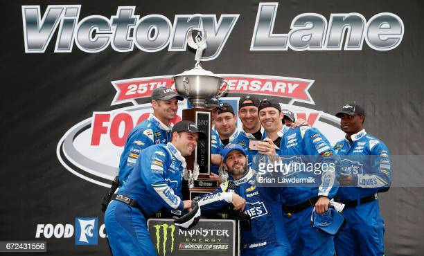 Jimmie Johnson driver of the Lowe's Chevrolet and his crew members take a selfie in Victory Lane after winning the Monster Energy NASCAR Cup Series...