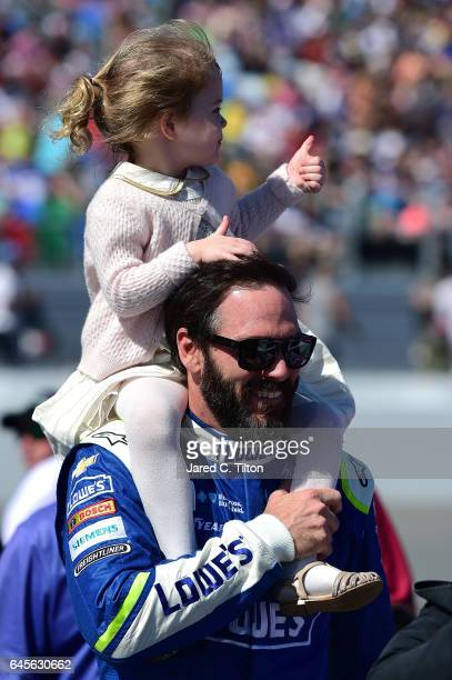 Jimmie Johnson driver of the Lowe's Chevrolet and his daughter Lydia Norriss walk the grid prior to the 59th Annual DAYTONA 500 at Daytona...