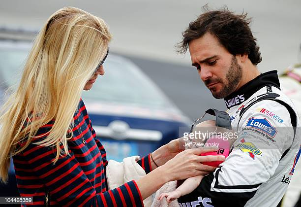 Jimmie Johnson driver of the Lowe's Chevrolet and his wife Chandra play with their daughter Genevieve Marie on the grid prior to the NASCAR Sprint...